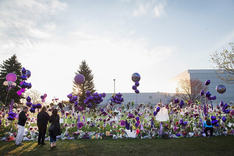 Music fans visit a memorial created outside Paisley Park, the former home and studio of Prince, on April 23, 2016, in Chanhassen, Minn.Scott Olson/Getty Images