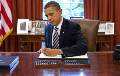 President Obama signs the budget bill. (Pete Souza/The White House via Getty Images)