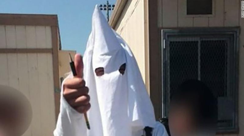 A student tweeted this photo of a classmate who wore a Ku Klux Klan costume for a class project.