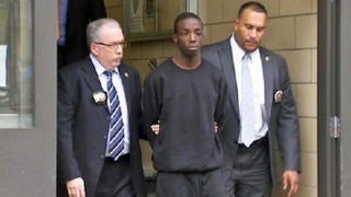 Marcell Dockery (center) being escorted by law-enforcement agentsTwitter