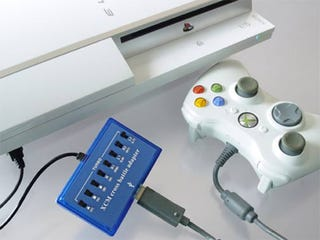 Illustration for article titled Cross Battle Adapter Brings Xbox 360 Controller to PS3, With Rumble