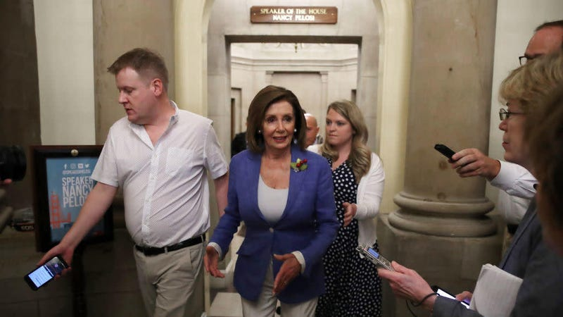 House Speaker Nancy Pelosi (D-Calif.) walks out of her office after a meeting with Rep. Alexandria Ocasio-Cortez (D-N.Y.), on Capitol Hill July 26, 2019.