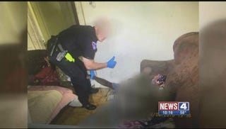 Recently surfaced photo of a North County (Mo.) Police Cooperative with the body of Omar Rahman, 28, who reportedly died of a drug overdose in August 2016. KMOV-TV screenshot