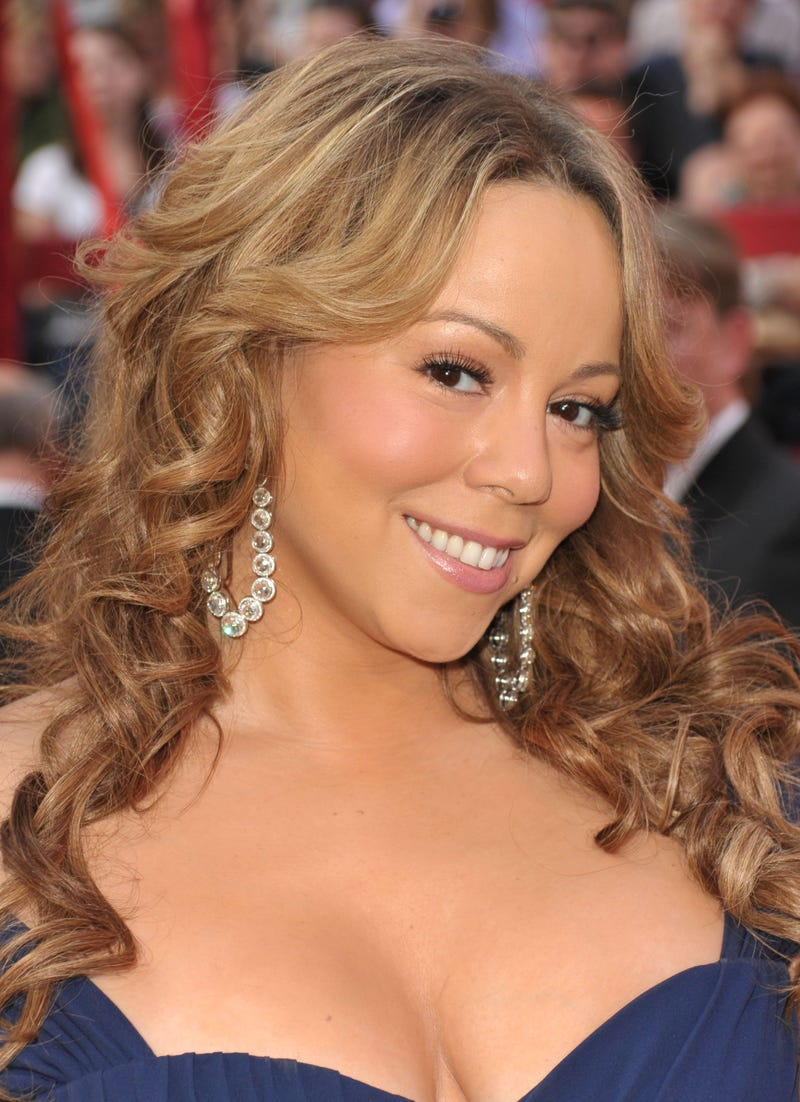 "Songstress Mariah Carey is ""embarrassed"" by Qaddafi ties."