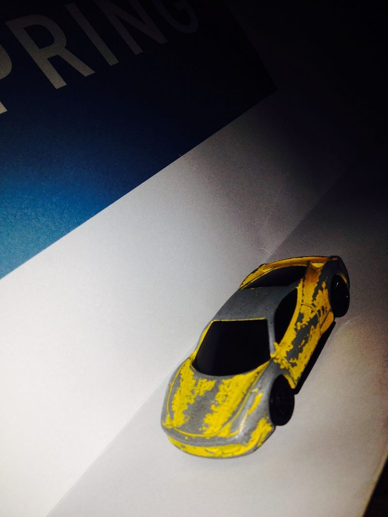 Illustration for article titled Presenting: the most beat-up (but still butt-kicking) 1:64 Ferrari 458 ever