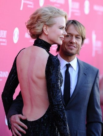 Illustration for article titled Keith Urban Says Nicole's Not Pregnant; Funeral Plans Set For Michael
