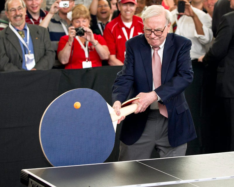 Illustration for article titled Here's Warren Buffett Swinging A Ridiculous, Supersize Ping-Pong Paddle