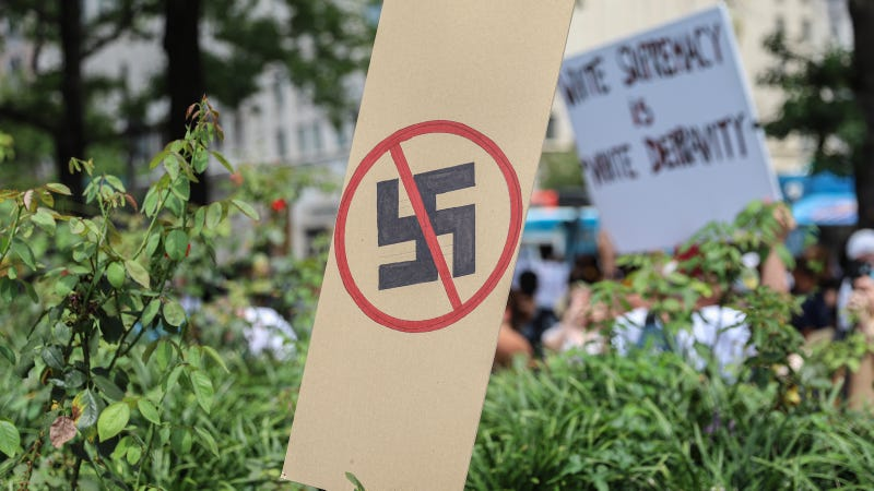A anti-Nazi sign stands as counter protesters gather at Freedom Plaza before the Unite the Right rally in Lafayette Park on August 12, 2018 in Washington, DC.