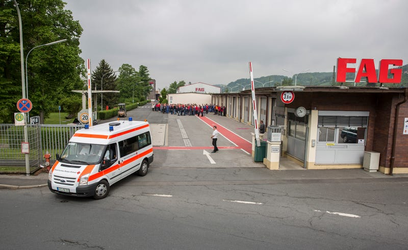 An ambulance leaves the FAG Schaeffler building on Monday morning following the explosion. Photo credit: Rene Ruprecht/dpa via AP