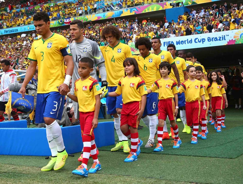 Illustration for article titled Report: Probably Some Reason Soccer Players Entering Stadium With Small Children
