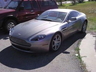 Illustration for article titled Aston Martin Vantage Dumped On Roadside Sale Lot