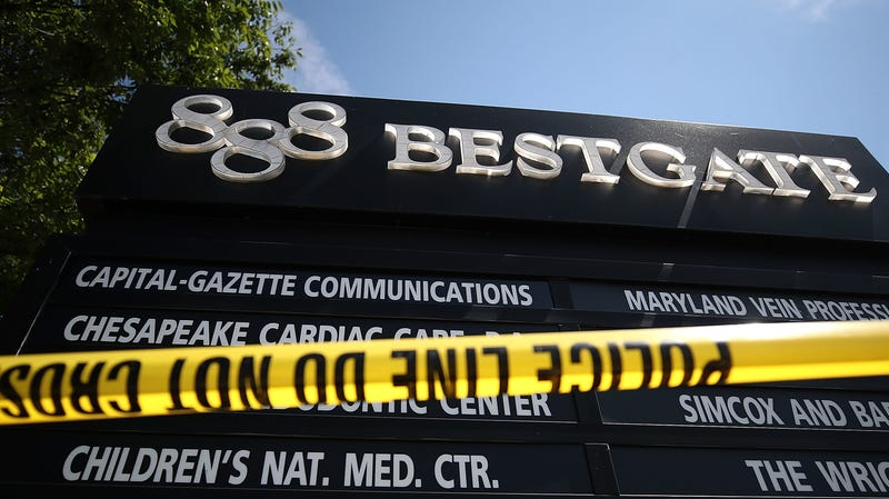 Police tape surrounds the entrance to 888 Bestgate Dr. where 5 people were shot and killed at the Capital Gazette headquarters, on June 29, 2018 in Annapolis, Maryland.