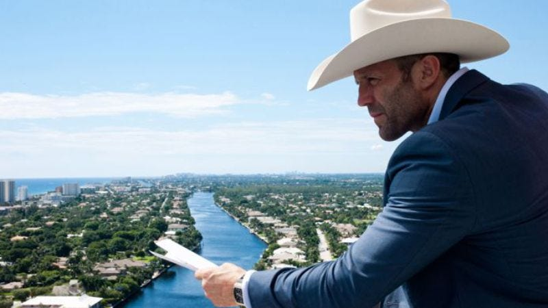 Illustration for article titled Caption Contest: What is Jason Statham thinking?
