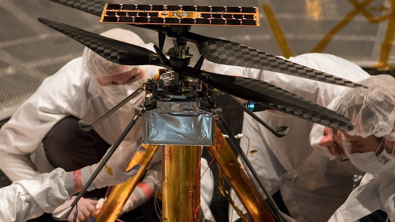 NASA engineers inspecting the Mars helicopter.