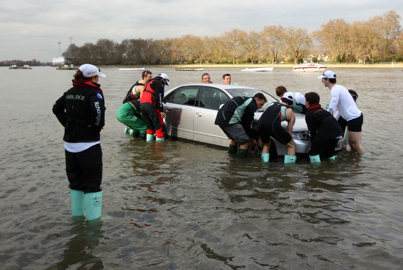Illustration for article titled Rowers rescue flooded cars during boat race