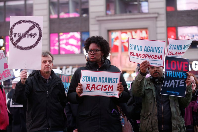 Members of MoveOn.org Political Action stand outside the studios of 'Good Morning America' to broadcast messages of love, dignity, and equality and stand up against the hate, racism, and incitement of violence that the group says has become a hallmark of Donald Trump's presidential campaign, March 16, 2016, in New York City.