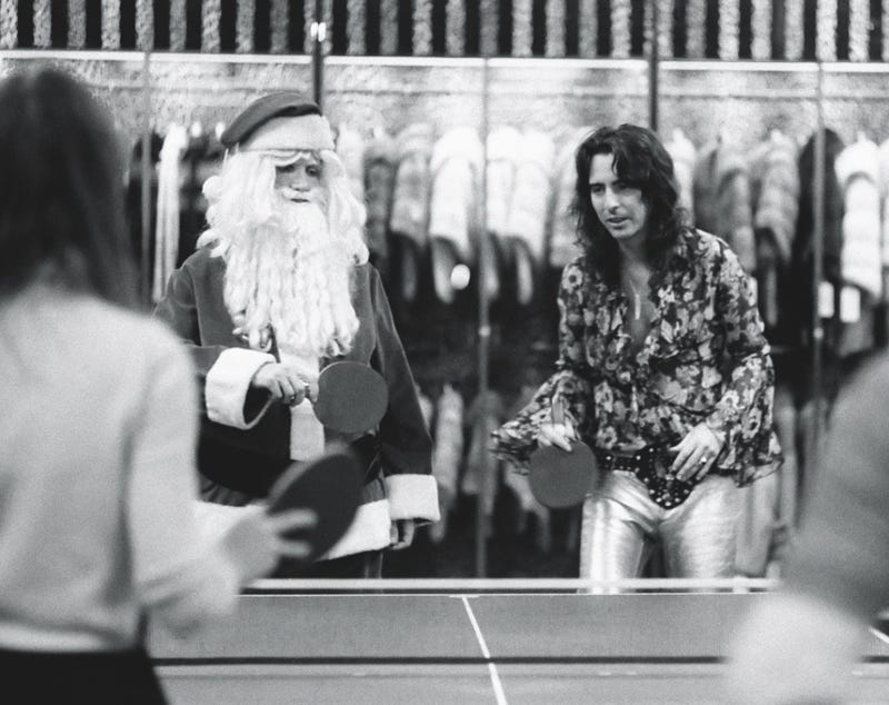 Illustration for article titled Alice Cooper playing ping pong with Santa?