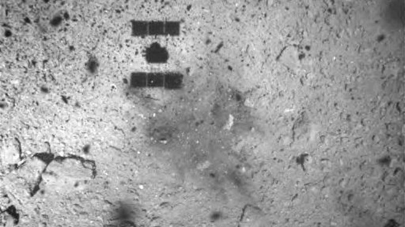 The shadow of Hayabusa2 can be seen on the asteroid's surface, along with the new dark smudge at the touchdown site.