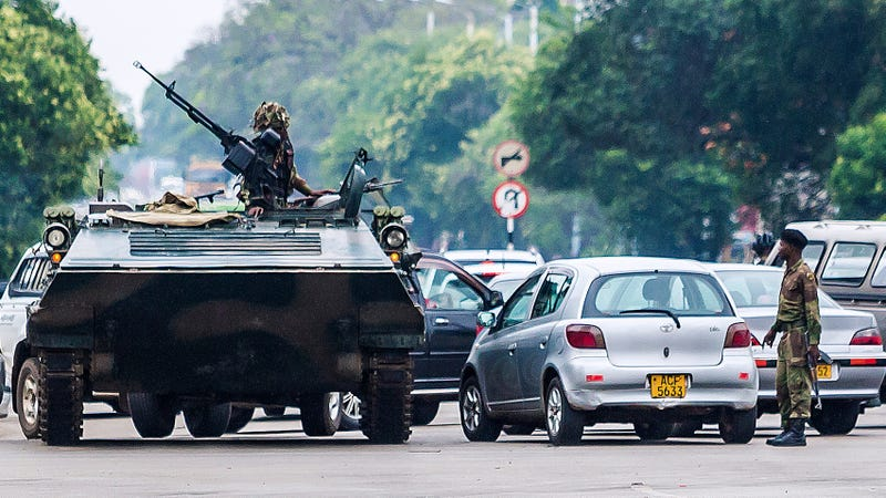 """Zimbabwean soldiers regulate traffic in Harare, the capital, on Nov. 15, 2017. Zimbabwe's military appeared to be in control of the country as generals denied staging a coup but used state television to vow to target """"criminals"""" close to President Robert Mugabe. (AFP/Getty Images)"""