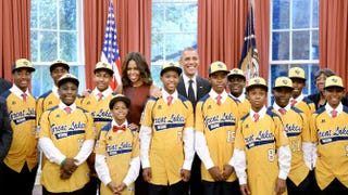President Barack Obama and first lady Michelle Obama meet with the Jackie Robinson West All Stars in the Oval Office of the White House, Nov. 6, 2014, in Washington, D.C.Olivier Douliery-Pool/Getty Images