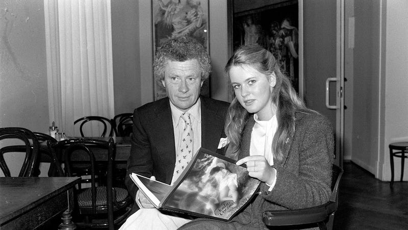 Hamilton holds his book Tender Cousins as he introduces 16-year-old Anja Schute to the press at Hamburg in 1981. Schute starred in Hamilton's movie by the same name. Photo via AP.
