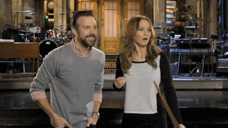 Illustration for article titled Jennifer Lawrence Smothers Jason Sudeikis with False Praise in This Week's SNL Promos