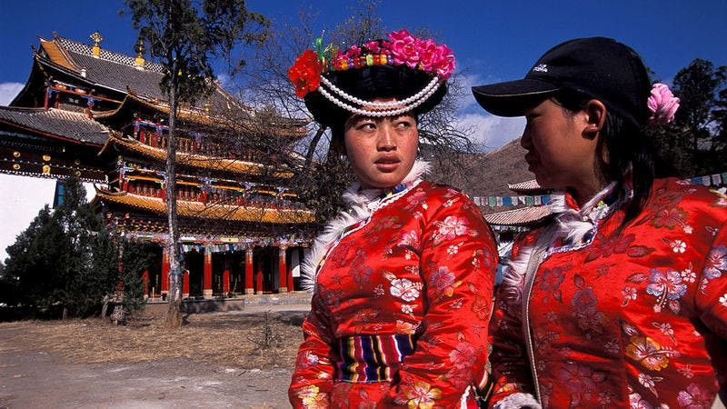 Two Mosuo women visit the Buddhist temple in Yongning, China (Christopher Pillitz/Getty Images)