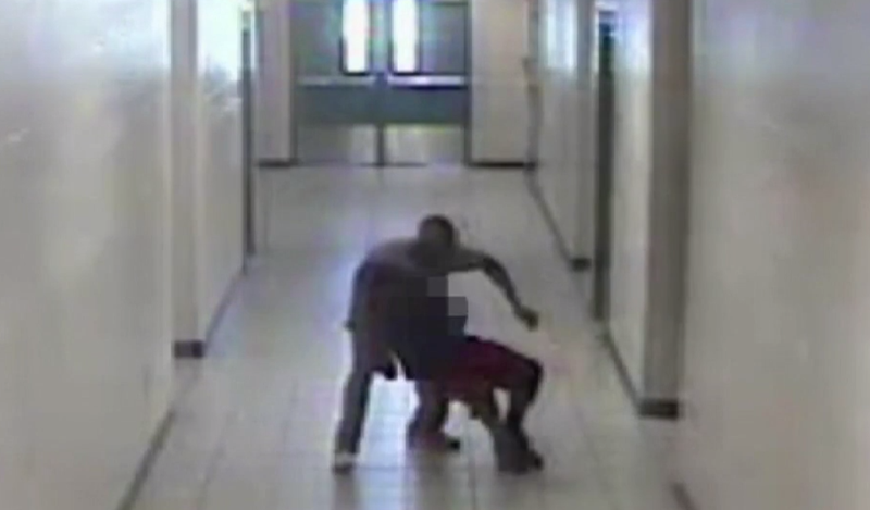 Surveillance footage shows school security guard Robert Fields dragging a student to the ground by his neck at Arlington High School in Virginia.WJAX-TV screenshot