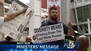 "A press conference held in Cincinnati May 20, 2015, to urge Major League Baseball to take a stance against police brutality against black men was interrupted by several white protesters, including one holding a sign that read, ""Diversity Means Chasing Down the Last White Person #WhiteGenocide.""WLWT screenshot"