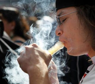 Rob Vallela of Denver smokes as thousands gather to celebrate Colorado's medicinal-marijuana laws and collectively light up at 4:20 p.m. on April 20, 2012, in Denver's Civic Center Park.Marc Piscotty/Getty Images