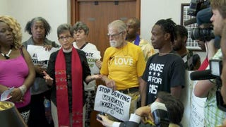 Protesters address the media inside North Carolina House Speaker Thom Tillis' office on Tuesday, May 27, 2014, in Raleigh, N.C.PHOTO COURTESY OF FUSION FILMS