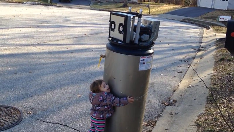 Girl adorably mistakes water heater for robot