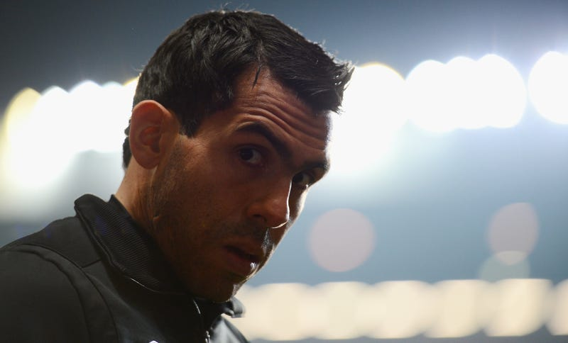 Illustration for article titled Carlos Tevez, Banned From Driving For Speeding In His Hummer, Was Arrested In His Porsche