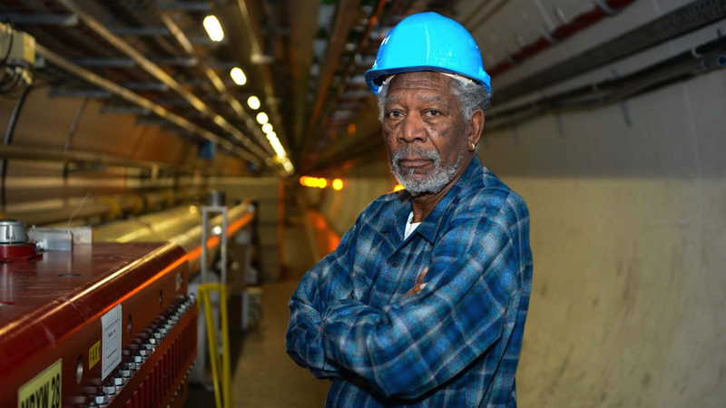 Illustration for article titled Morgan Freeman, in a CERN hard hat, inside the Large Hadron Collider