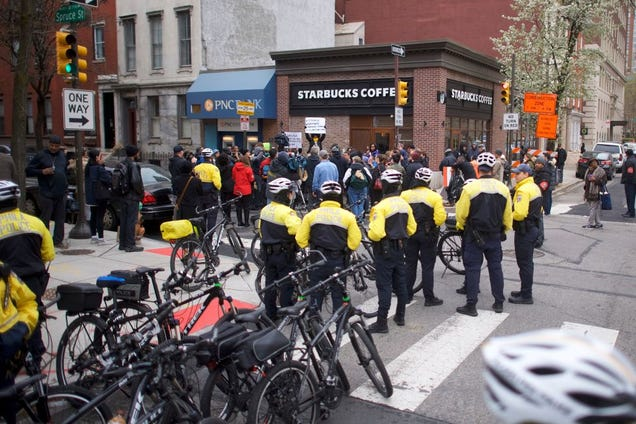 Police monitor activity as protesters demonstrate outside a Center City Starbucks on April 15, 2018, in Philadelphia.