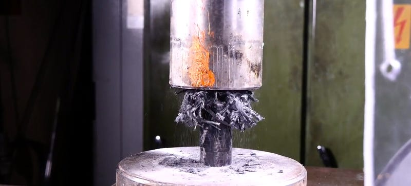Illustration for article titled Carbon Fiber Does NotDo What You Expect When You Crush It With A Hydraulic Press