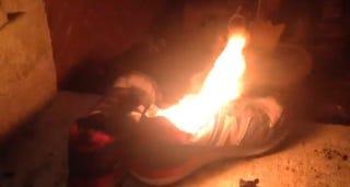 A burning New Balance sneakerTwitter