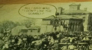 The photo with the tasteless caption that was embedded into the decorative table at Joe's Crab Shack in Roseville, Minn.WCCO screenshot