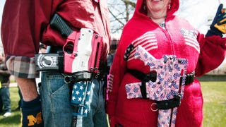 Marty and Chris Welch of Cadillac, Mich., carry decorated Olympic Arms .223 pistols at a rally for supporters of Michigan's open-carry law April 27, 2014, in Romulus, Mich. The march was held to attempt to demonstrate to the general public what the typical open carrier is like.Bill Pugliano/Getty Images