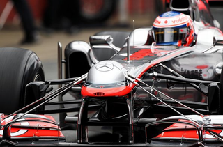 Illustration for article titled What the hell is the bump on this Mclaren's nose?
