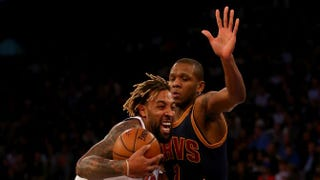 Derrick Williams of the New York Knicks heads for the net as James Jones of the Cleveland Cavaliers defends during a game in New York City Nov. 13, 2015.Elsa/Getty Images