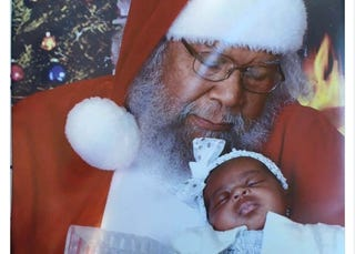 Chocolate Santa (Fred Parker) has been taking photos with children in New Orleans for 46 years. Twitter Screenshot