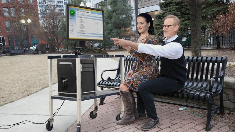 Illustration for article titled Blossoming Romance? Katy Perry Was Just Spotted Sitting On Steven Spielberg's Lap While He Showed Her The Ins And Outs Of Norton AntiVirus