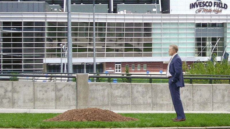 Illustration for article titled Broncos Quietly Bury Peyton Manning In Unmarked Grave Next To Stadium