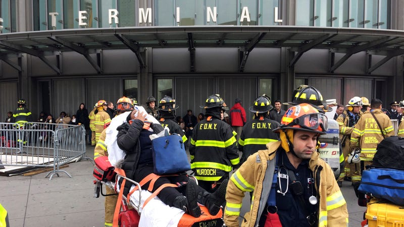 An injured passenger assisted by EMS workers after a Long Island Rail Road incident Jan. 4, 2017, in the Brooklyn borough of New York (AP)