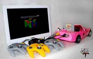Illustration for article titled Guy Turns Nintendo 64 Into Hot Pink Barbie Corvette