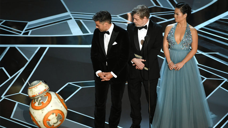 BB-8, Oscar Isaac, Mark Hamill, and Kelly Marie Tran onstage at the 90th Annual Academy Awards. Or...a dramatic interpretation of Academy voters looking at one of those popular films. Who can say?