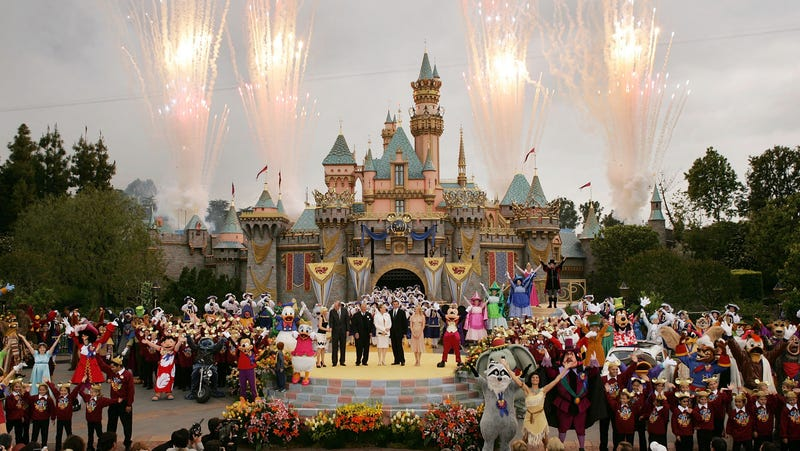 Fireworks explode under cloudy skies as Disney dignitaries and characters appear in front of Sleeping Beauty Castle at the close of ceremonies for the 50th anniversary of Disneyland May 5, 2005 in Anaheim, California.