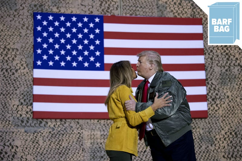 Illustration for article titled President Trump and Melania Visit Iraq, Smooch