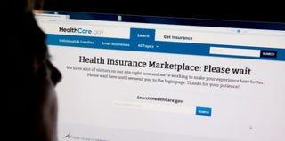 A woman looks at the HealthCare.gov insurance exchange internet site Oct. 1. (KAREN BLEIER/AFP/Getty Images)